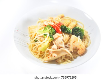 Spaghetti Oglio serve on plate with isolated white background