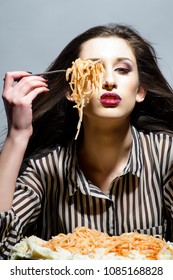 Spaghetti on fork. Girl keeping fork with spaghetti. Young woman eating italian pasta.