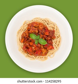 Spaghetti on plate top view with clipping path against green background