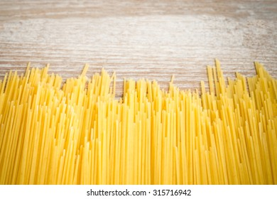 spaghetti on wooden background