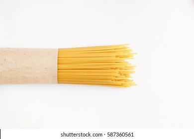 Spaghetti packed into paper on a white background. Supermarket.