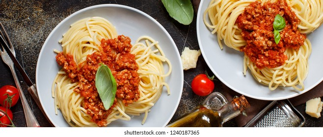 Spaghetti pasta with bolognese sauce on a dark table top view