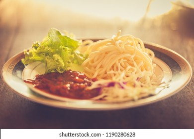 spaghetti pasta, lettuce and meat salsaa in a beautiful plate in the morning