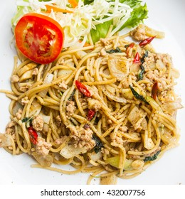 spaghetti pasta with pork and sweet basil, thai style cuisines