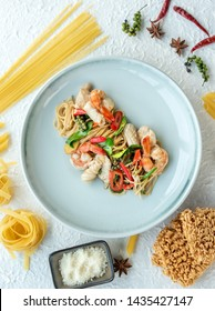Spaghetti pasta Scallop and seafood in tomato sauce with pasta sauce, parsley in pan. sea food spaghetti in white dish on table. Plate of Italian spaghetti food is Spaghetti Scallop pesto clam.