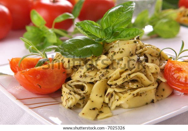 Spaghetti with pesto sauce and cheese
