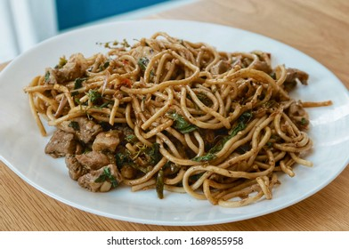 spaghetti pork with basil and herb