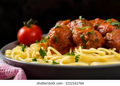 Spaghetti with pork and beef meatballs and tomato sauce - close up view