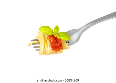 Spaghetti rolled on fork with tomato and basil