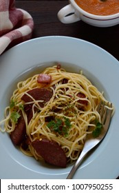 Spaghetti with salami is a pasta dish made with boiled spaghetti stir fried with salami, garlic, pepper, and dried chili peppers.