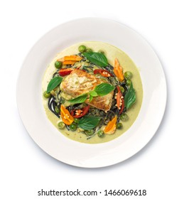 Spaghetti Salmon in Green Curry Sauce in coconut milk sweet and hot tasty Thai food fusion style decorate vegetables and chili top view