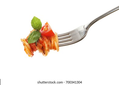 Spaghetti with sauce and basil and tomato on a fork isolated against white