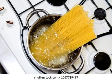 spaghetti in a saucepan on the stove