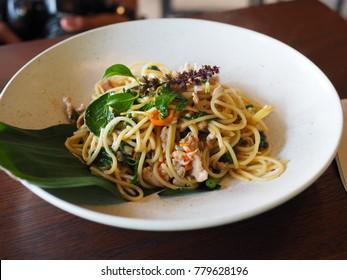 spaghetti seafood on white plate