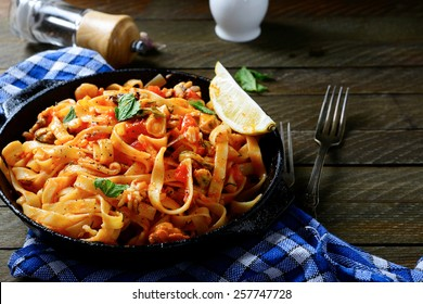 Spaghetti with seafood in a pan, mediterranean food