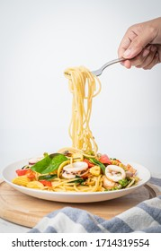 spaghetti with seafood sauce and basil, food concept background.