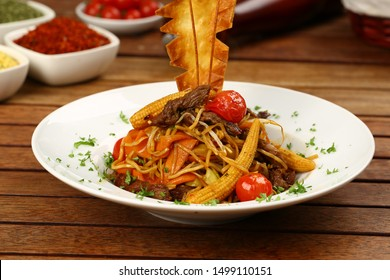 Spaghetti with soy sauce and corncob in bowl
