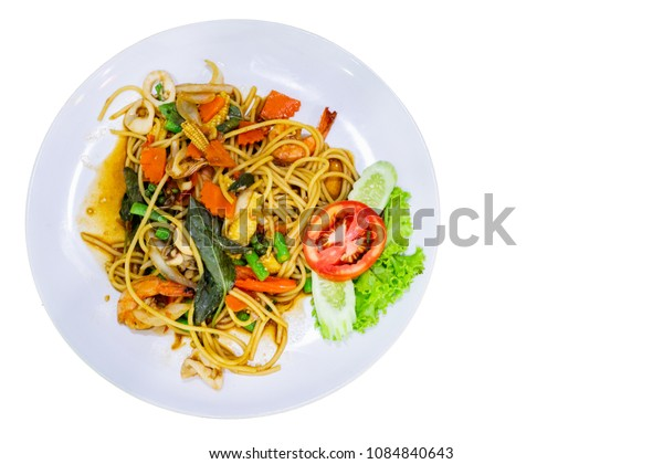 Spaghetti with Spicy Mixed Seafood on white plate isolated white background.