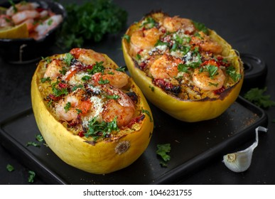 Spaghetti squash baked with shrimps, dried tomatoes, parmesan cheese and herbs - gluten-free healthy pasta recipe