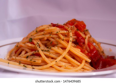 Spaghetti with tomato and basil on the dish