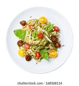 Spaghetti with tomato and basil on white background