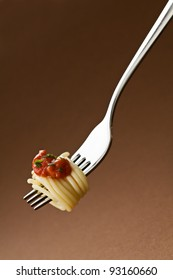 Spaghetti with tomato on fork close up shoot