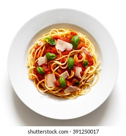 Spaghetti with tomato sauce, basil and cheese. Isolated on white from above.
