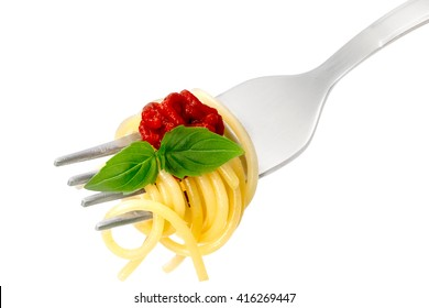 Spaghetti with tomato sauce and basil leaves on a fork. Infinite depth of field, clipping path