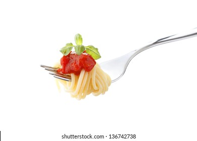 Spaghetti with tomato sauce and basil on fork, isolated on white background. Close-up shoot, shallow focus.