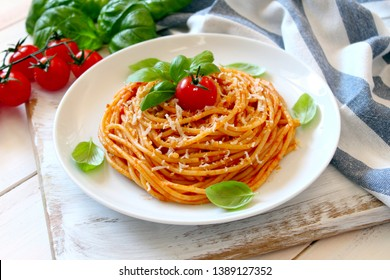 Spaghetti with tomato sauce. Top view with copy space.
