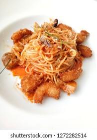 Spaghetti tomyum kung on white plate