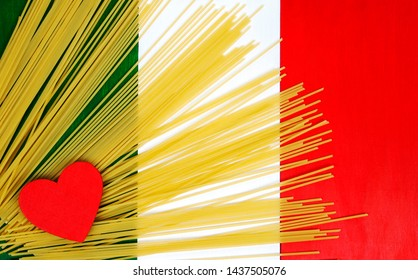 Spaghetti - traditional raw spaghetti with Italian flag background and heart concept - dynamic design for love of cooking, food, and recipes from Italy.