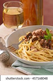 Spaghetti with tuna, capers and eggplant - Traditional Italian recipe