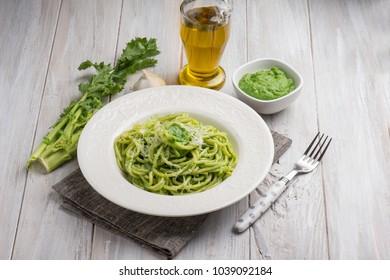 spaghetti with turnip top pesto and parmesan cheese