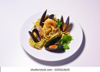 Spaghetti whith sea fruit, Spaghetti ai frutti di mare, seafood mediterranean gastronomy