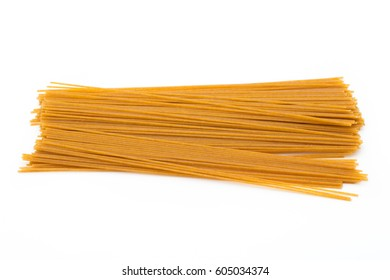 Spaghetti yellow pasta, ready for cooking, isolated on the white background.