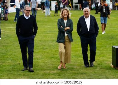 A Coruña, Spain .07/30/2016. Pablo Isla (L),CEO Inditex, with Amancio Ortega Gaona (R), founder Inditex empire and his wife Flora Pérez(C)