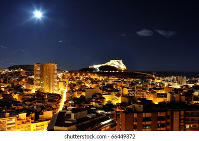Spain, Alicante at night with castle