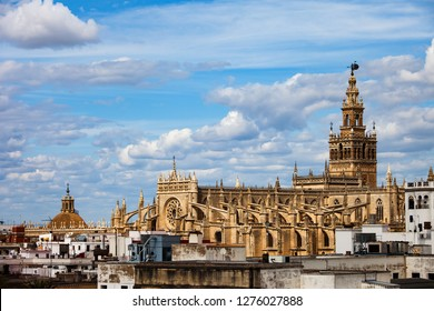 Spain, Andalusia, city of Seville, Cathedral of Saint Mary of the See (Spanish: Catedral de Santa Maria de la Sede) in Old Town skyline, Gothic style architecture