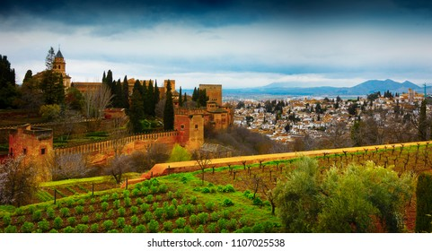 Spain, Andalusia / Granada - March 17, 2018: Alhambra - ancient arabic fortress and architectural and park ensemble located on a hilly terrace in the eastern part of Granada in Southern Spain.