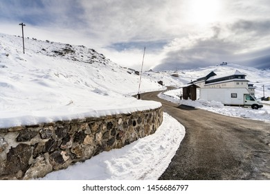 Spain, Andalusia, Granada. Road in ski resort of Sierra Nevada in winter, full of snow. Travel and sports concepts.