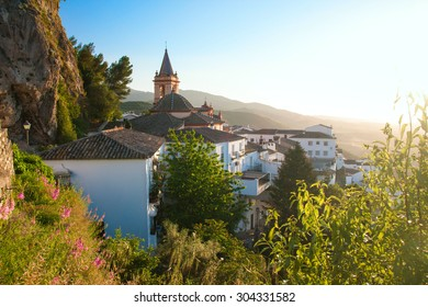 SPAIN, ANDALUSIA ZAHARA: View on old church during sunset in beautiful Spanish town: Zahara in Andalusia. It is considered to be one of the pueblos blancos or white town.