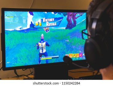 Almería, Spain - August 03, 2018: Teenager winning a Victory Royale in Fortnite videogame, the multiplayer Battle Royale game developed by Epic Games.
