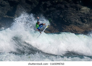Pantín, Spain - August 25, 2018: The surfer Joaquim Chaves in the Junior Qualifying Series of the World Surf League Pantin Junior Pro