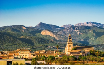 Spain Balearic Islands, Majorca panorama landscape view of the village Santa Maria del Cami with church and Tramuntana Mountains.