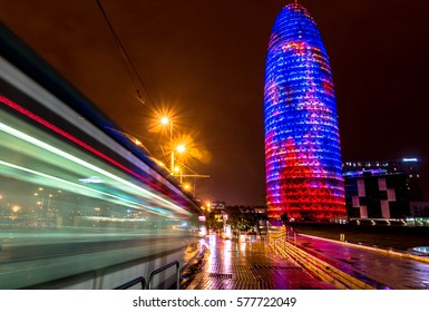 SPAIN, BARCELONA - 12 FEB 2017: A long exposure shot of moving tram with Agbar Tower on the background.