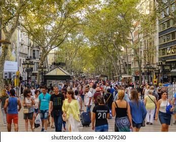 Spain, Barcelona, 14-09-2016. Picture is showing people in downtown Barcelona in popular La Rambla street.