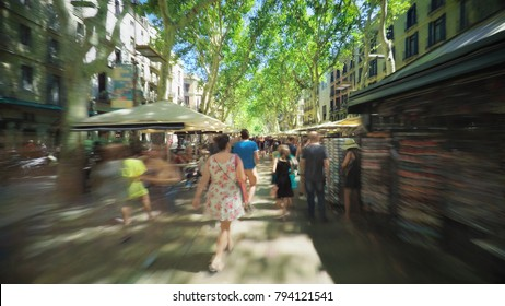 SPAIN BARCELONA JULY 2017: La Rambla street Hyperlapse, tourists walking along long pedestrian road at sunny day, smooth steady timelapse video footage