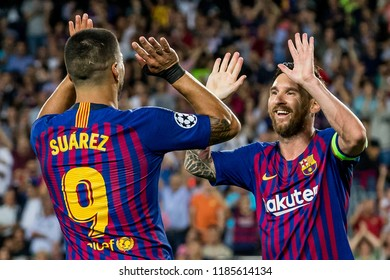 SPAIN, BARCELONA - September 18 2018: Lionel Messi (r) scores and celebrates with Luis Suarez (l) During the FC Barcelona - PSV Champions League Match