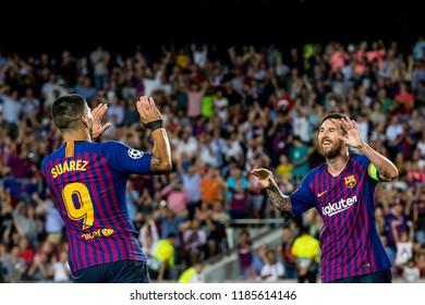 SPAIN, BARCELONA - September 18 2018: Lionel Messi (r) scores and celebrates with Luis Suarez (l) During the FC Barcelona - PSV Champions League Match